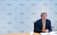 Bach says IOC 'committed' to Tokyo Olympics, admits fans may be barred