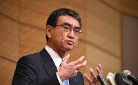 Japan's vaccines minister, Kono, leads opinion poll on succeeding Suga