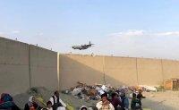 Gunfire at Kabul airport kills 1 amid chaotic evacuations