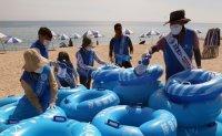 Disinfecting flotation tubes at beach