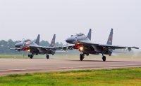 China sends 56 jets into Taiwan defense zone