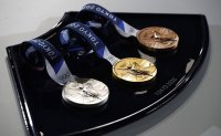 Gold medalists take home de facto silver medals