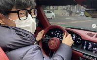 Famous online video streamer flaunts his new Porsche - possibly electric Taycan