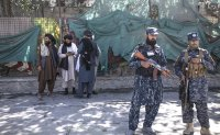 Spy agency monitoring foreign nationals who threatened Afghan evacuees: report