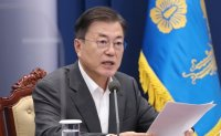 Moon thanks Buddhist community for solidarity in virus fight