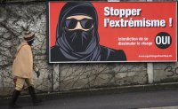Swiss citizens vote on proposal to ban face coverings in public