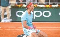 Perfect in Paris, Nadal overwhelms Djokovic to tie Federer