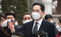 Samsung chief to be released on parole Friday