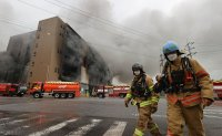 Fire at Coupang warehouse rages for over a day; 1 firefighter trapped