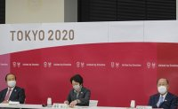 Japan reassures Olympics can be safe as extended state of emergency considered