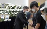 Moon visits funeral home of sex assault victim in military