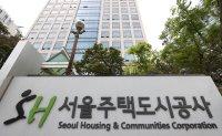 Police search public housing developer in bribery investigation