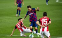 Barcelona beats Athletic 1-0 to move back in front of Madrid