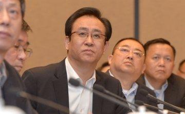 Top financial regulator urges market monitoring over Evergrande concerns