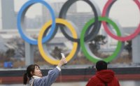 Will they, won't they? Key questions for troubled Tokyo Olympics