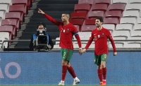 Ronaldo scores in round of friendlies affected by virus