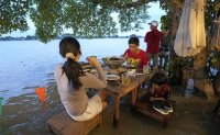 Riverside restaurant makes waves in Thailand as flood dining goes viral