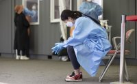 New virus cases in 700s for 2nd day