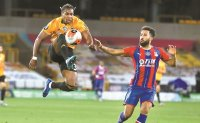 Wolves bolster Europa League bid, Blades blunted by Everton