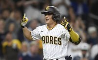 Padres lose Tatis, beat Reds 7-5 on Kim's 2-run homer in 8th
