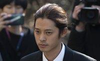 K-pop singer embroiled in sex scandal arrives at court