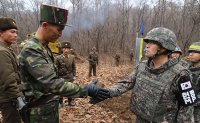 South and North Korean soldiers encounter to reconnect a road in DMZ