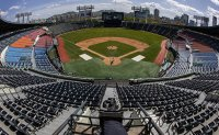 Baseball returns to South Korea without fans [PHOTOS]