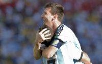Argentina, Belgium hang on to reach quarters