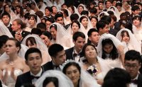 Mass wedding: 4,000 couples exchange vows at same time, same place