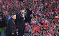 North Korea, China leaders say boosting ties is good for regional peace