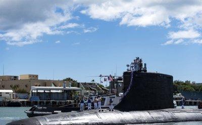 US reassures livid France after Australia scraps submarine deal