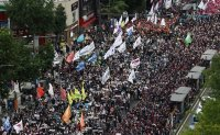 Umbrella union to hold large-scale rally during next week's one-day general strike