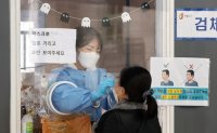 New virus cases slightly dip amid speedy vaccination campaign