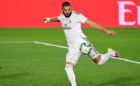 Real Madrid beats Valencia 3-0 to keep pace with Barcelona