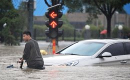 Survivors tell of rising water and last goodbyes as disaster claims at least 25 lives and displaces thousands in China