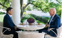 Crab cakes served as main lunch course for Moon and Biden