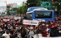 Umbrella union holds street rally despite virus concerns