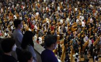 Christians wearing masks attend church service amid pandemic [PHOTOS]