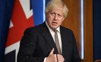 England set to lift virus restrictions despite soaring cases