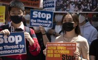 Young Koreans lash out at heavy-handed China