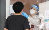 New virus cases fall below 500 ahead of revised social distancing rules