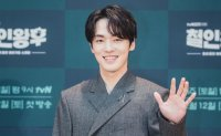 Kim Jung-hyun settles dispute with former management agency