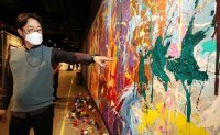 Street art displayed in Lotte World Mall vandalized