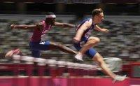 Warholm wins 400m hurdles gold, smashes world record
