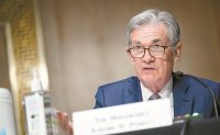 US Fed keeps key rate near zero, sees inflation as 'transitory'