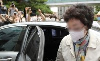 Ex-prosecutor general's mother-in-law jailed for fraud