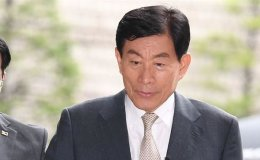 Ex-spy chief sentenced to 9 years in prison in retrial of political meddling case