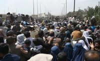 Taliban killings fuel fear, drive more chaos outside airport