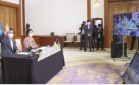 Moon holds online meeting with kids for Children's Day