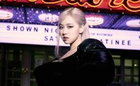 Rose's first solo album 'R' becomes 'half million seller'